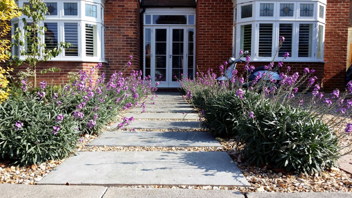 Beautifully balanced design in front garden lilybud for Soft landscape materials